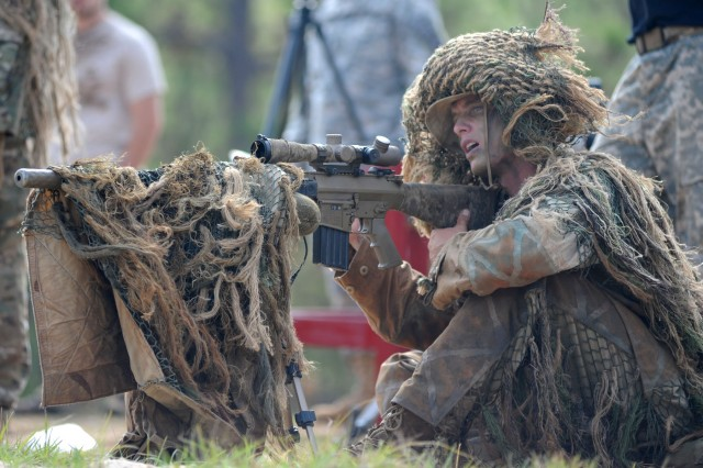 Spec. Lawrence England looks toward his target during the annual sniper competition touting the world's best snipers at Fort Benning, Ga. England is a sniper with the Hawaii-based 25th Infantry Division.
