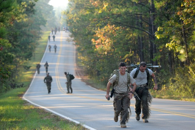 Sniper teams from throughout the U.S. military, as well as a police SWAT team and international competitiors run a two-mile course during the 72-hour sniper competition at Fort Benning, Ga.