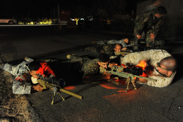 Snipers take a prone position to make final adjustments during the night fire portion of the 10th annual International Sniper Competition held at Fort Benning, Ga.