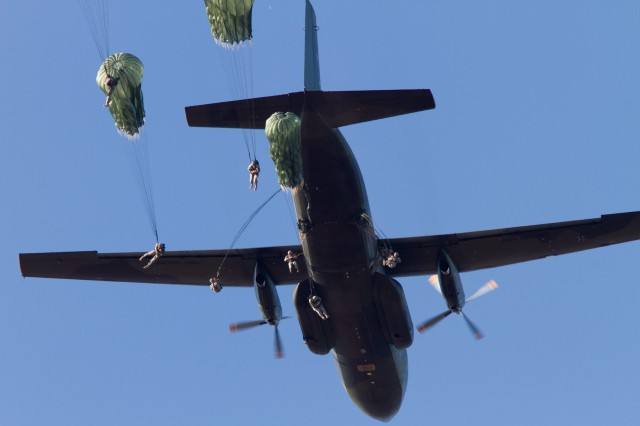 Paratroopers with the 82nd Airborne Division exit a German C-160 aircraft over Sicily Drop Zone on Fort Bragg, N.C., Oct. 6, 2010, as part of Operation Federal Eagle during which over 800 American Paratroopers earned German jump wings.  German jumpmasters aboard the aircraft lead the jump.