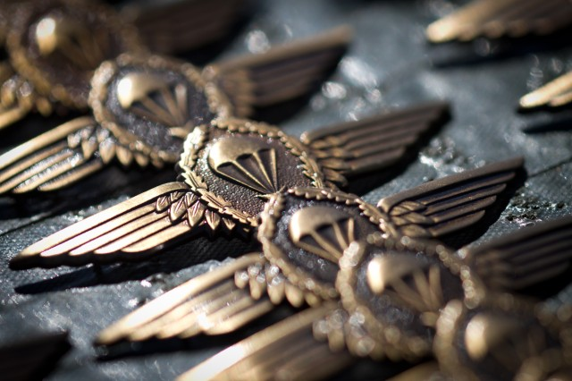German jump wings sit on a table prior to a pinning ceremony for U.S. Army Paratroopers who will earn them for jumping from a German aircraft with German jumpmasters at Fort Bragg, N.C., Oct. 5-7, 2010.  Over 800 Paratroopers with the 82nd Airborne Division will earn the wings.
