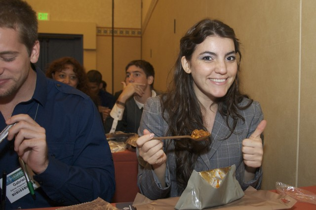 Marilen Natalia Costarelli from Florida International University gives a Meal-Ready-to-Eat a thumbs up Oct. 8 at the Hispanic Engineer National Achievement Award Conference in Orlando. Fla.