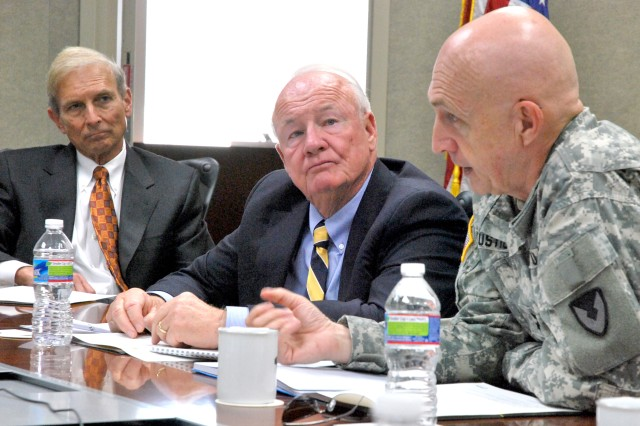 Maj. Gen. Nick Justice, right, senior installation commander, Aberdeen Proving Ground, Md., discusses a proposed University of Maryland expansion as Edward St. John, president of St. John Properties, left, and former Maryland State Senator Frank Kelly, center, listen.