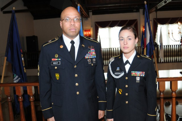 """Sgt. 1st Class Edward Mosley stands with Staff Sgt. Alicia Anderson just after her board appearance during the 2010 Department of the Army Noncommissioned Officer and Soldier of the Year """"Best Warrior"""" Competition taking place Oct. 17-22 at Fort Lee, Va.  Anderson represents U.S. Army Europe."""