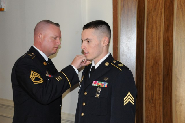 """Sgt. John Evans, the Soldier competitor from Medical Command, competes in the Board Appearance Oct. 18  at the 2010 Department of the Army Aca,!A""""Best WarriorAca,!A? NCO and Soldier of the Year competition."""