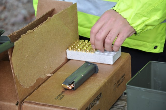 Nine-millimeter rounds are loaded into magazines Oct. 16 before pistol qualification by USAG-Natick police officers and security guards.