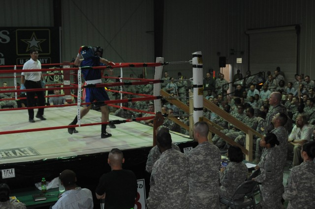 Two United States Division - Center Soldiers compete in the Boxing Smoker 2 Oct. 9 at Camp Liberty, Iraq. The event was hosted by Division Special Troops Battalion, 1st Armored Division, USD-C.