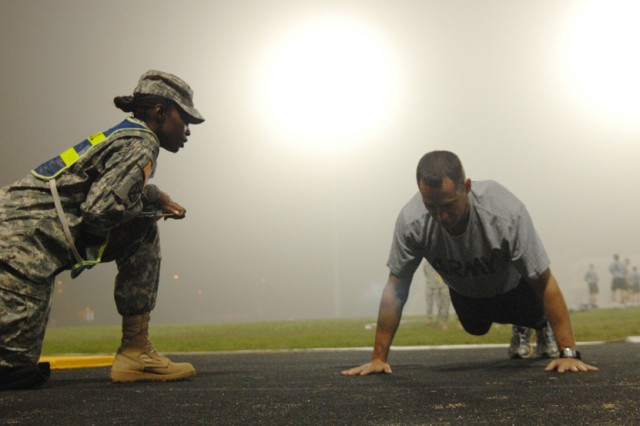 Spc. Justin Hinton completes one more push-up during the 2010 U.S. Army Best Warrior Competition Army Physical Fitness Test Oct. 19 at Fort Lee, Va. Hinton is a satellite communications system operator assigned to Fort Benning, Ga. He is representing the U.S. Army Special Operations Command during the week-long competition. (Photo by Patrick Buffett)
