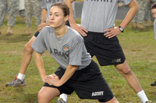 Sgt. Sherri Gallagher participates in stretching exercises during the 2010 U.S. Army Best Warrior Competition Army Physical Fitness Test Oct. 19 at Fort Lee, Va. Gallagher is one of 24 individuals competing for the title of U.S. Army Noncommissioned Officer or Soldier of the Year. Gallagher is a motor transport operator assigned to Fort Benning, Ga. She is representing the U.S. Army Training and Doctrine Command during the week-long competition. (Photo by Patrick Buffett)