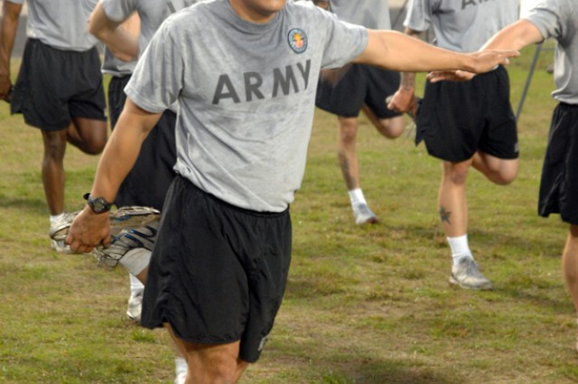 Staff Sgt. Loren Gernandt participates in stretching exercises during the 2010 U.S. Army Best Warrior Competition Army Physical Fitness Test Oct. 19 at Fort Lee, Va. Gernandt is one of 24 individuals competing for the title of U.S. Army Noncommissioned Officer or Soldier of the Year. He is representing U.S. Army Forces Command during the week-long competition. (Photo by Patrick Buffett)