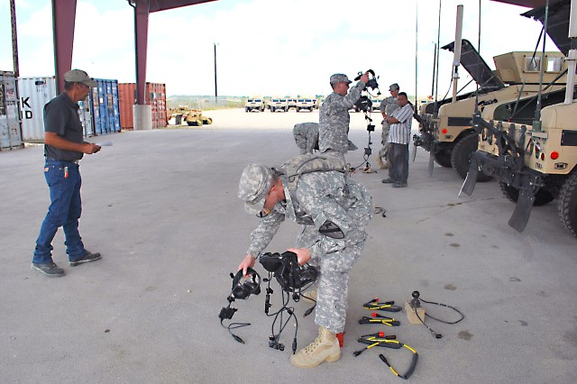 Donald Ford, PDTE supply technician, 407th AFSB, assists Fort Hood, Texas, Soldiers conduct inventory of BII, or basic issue items.