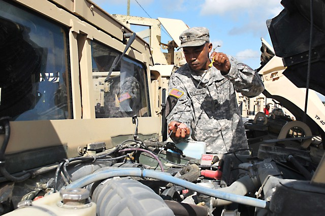 A 1st Cavalry Division Soldier at Fort Hood, Texas, checks the oil on a Humvee as part of the preventive maintenance checks & services conducted before his unit receives Pre-deployment Training Equipment.