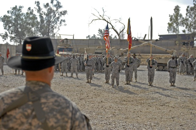 CONTINGENCY OPERATING SITE MAREZ, Iraq - Lt. Col. Robert Magee (foreground), commander of the 5th Battalion, 82nd Field Artillery Regiment, 4th Advise and Assist Brigade, 1st Cavalry Division, stands ready to uncase his battalion's colors during the unit's transfer of authority ceremony, Oct. 12.