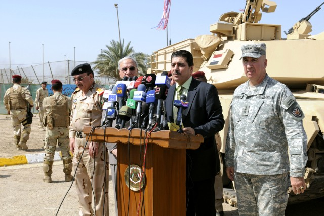 Iraqi dignitaries and the United States Forces-Iraq Deputy Commanding General for Advising and Training, U.S. Army Lt. Gen. Michael D. Barbero speak to the media during a ceremony celebrating the transfer of the first two of 140 tanks scheduled for fielding in the Iraq Army at Camp Iraqi Hero Oct. 14.