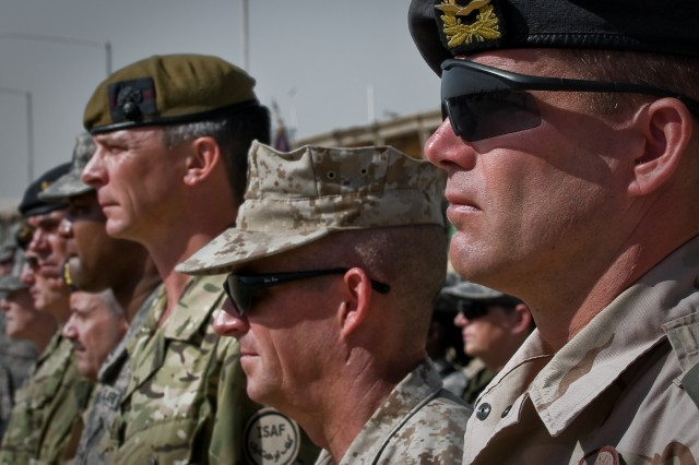 """Multinational military servicemembers stand in attendance during the Joint Sustainment Command-Afghanistan transfer of authority ceremony Oct. 17 at Kandahar Airfield, Afghanistan."""""""