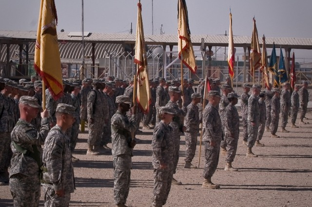"""Soldiers stand in formation to witness the Joint Sustainment Command-Afghanistan transfer of authority ceremony Oct. 17 at Kandahar Airfield, Afghanistan."""""""