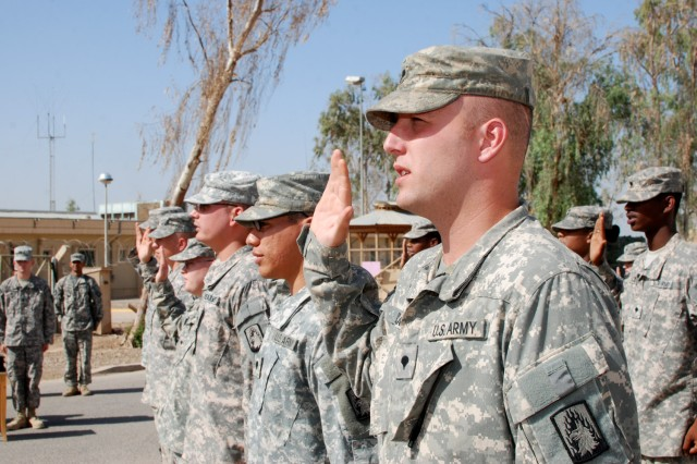 Soldiers serving in Iraq with the 3rd Battalion, 158th Aviation Regiment raise their hands to take the Oath of Re-enlistment, Oct. 19, in a ceremony on Joint Base Balad. (U.S. Army photo by Spc. Roland Hale, eCAB, 1st Inf. Div. PAO)