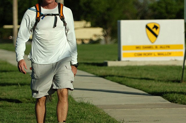 FORT HOOD, Texas-Lt. Col. Jack Usrey, personnel officer for the 1st Cavalry Division, walks past the division's headquarters during one of his many training walks.  Usrey, a Martin, Tenn. native, plans on completing a 100 mile trek in less than 48 hours, Oct. 28, to raise awareness for wounded warriors.