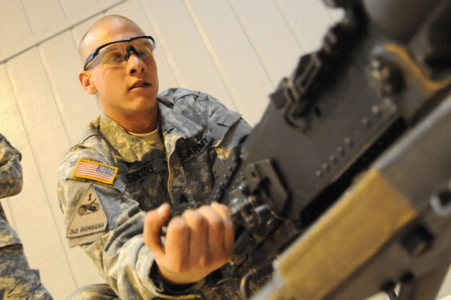 Sgt. Eric Sincore begins to disassemble a M2 .50 caliber machine gun during the training portion of the 2010 Best Warrior Competition.  The training is designed to provide a refresher for the participants prior to the Warrior Tasks and Battle Drills events that will take place for the remainder of the five-day competition.  Sincore, representing U.S. Army Europe, is one of 24 Soldiers and noncommissioned officers competing for honors at the Fort Lee, Va. event.  (photo by T. Anthony Bell)