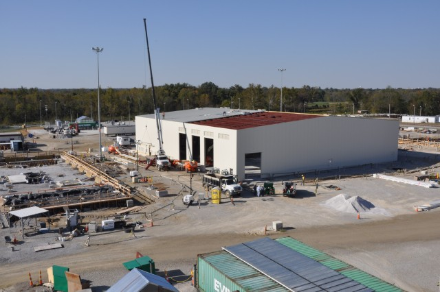 Sliding installation progresses on the Utility building which will house equipment to produce steam, compressed air, chilled water and hot water for plant operations. The Utility Building is being constructed by M. P. Kelly construction Company of Richmond, Ky.