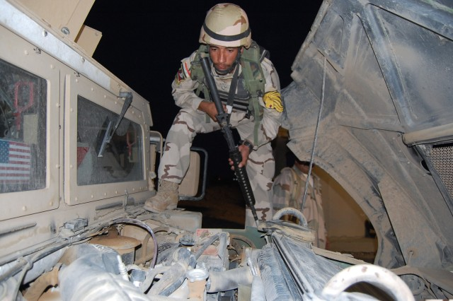CONTINGENCY OPERATING SITE MAREZ, Iraq - Pvt. Fayez Ramthan Ali, an Iraqi Army Soldier, inspects a humvee for possible explosive devices during a vehicle search training class taught by troops from 1st Squadron, 9th Cavalry Regiment, 4th Advise and Assist Brigade, 1st Cavalry Division.