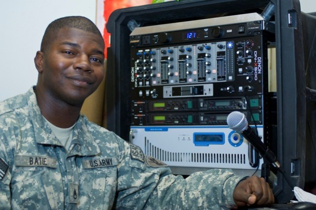 "Staff Sgt. Evan L. Batie, a reservist with the 319th Psychological Operations Co., 13th Psychological Operations Battalion, poses in front of the ""radio in a box,"" or RIAB, at Forward Operating Base Lightning, Paktya province, Afghanistan, Oct."
