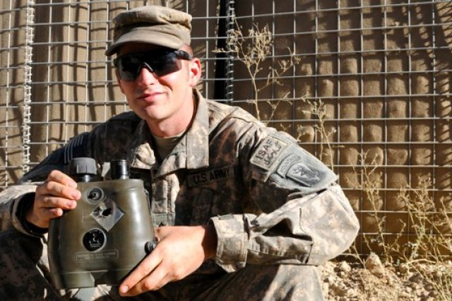 Pfc. Phil Mexcur, a fire support specialist, with Charlie Company, 3rd Battalion of the 172nd Infantry (Mountain) Regiment, holds his vector binoculars that were hit by sniper rounds before being stopped by his side plate. Immediately after realizing he wasn't injured, he performed a casualty assessment of his platoon sergeant, gave the distance and direction of the sniper fire and directed close-air support, all within two minutes of being shot.