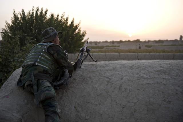 An Afghan Commando with 3rd Commando Kandak provides rooftop security during an operation to rid insurgents from Panjwa'i District, Oct. 15, 2010, in Kandahar Province, Afghanistan.