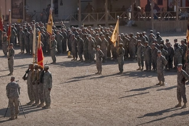 Soldiers stand in formation to witness the Joint Sustainment Command-Afghanistan transfer of authority during a ceremony Oct. 17 at Kandahar Airfield, Afghanistan.