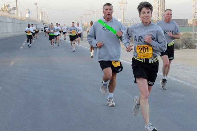 BAGRAM AIRFIELD, Afghanistan - Boiling Springs, N.C., resident U.S. Army Lt. Col. Teri Hassell, deputy commander, 359th Theater Tactical Signal Brigade, sets a good pace during the first half of the Army 10-Miler's shadow run here Oct. 17. (Photo by U.S. Army Capt. Michelle Lunato, 359th Theater Tactical Signal Brigade)