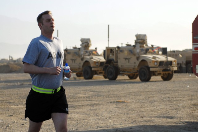BAGRAM AIRFIELD, Afghanistan - Soldiers competing in the Oct. 17 Army 10-Miler's shadow run at Bagram Airfield, Afghanistan, had to trade their scenic view of the Pentagon and Washington Monument for tactical vehicles and concertina wire. (Photo by U.S. Army Capt. Michelle Lunato, 359th Theater Tactical Signal Brigade)