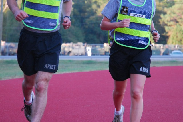 First Lt. Mike Reed and 2nd Lt. Judy Reed jog around the track outside of the 120th Adjutant General Battalion (Reception). Both will represent Fort Jackson in Sunday's Army Ten-Miler along with 21 other Soldiers.