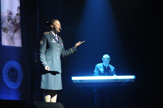 "Pfc. Rena Cunningham performs the song ""American Anthem"" accompanied by Spc. Alvaro Loaiza during Sunday's Soldier Show at the Solomon Center."