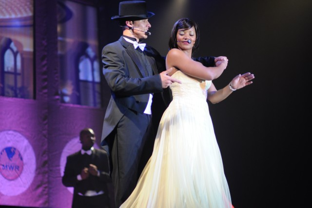 "Pfc. Andrew Enriquez and Spc. Demetria Stewart perform ""Cheek to Cheek"" as part of a tribute to the late Irving Berlin, the founder of the Soldier Show."
