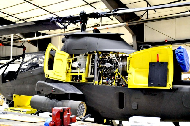 This AH-1 Cobra helicopter was refurbished at a hangar near Wheeler-Sack Army Airfield at Fort Drum. It was recently purchased by the Royal Thai Air Force and will ship to Bangkok later this year. Personnel working for the Foreign Military Sales program of the Directorate of Logistics' Aviation Logistics Management Division have stripped, refurbished and/or sold parts from hundreds of Cobra helicopters since 1999.