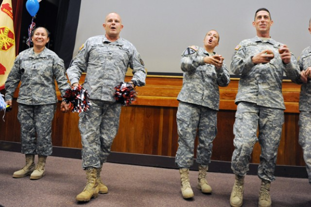 PRESIDIO OF MONTEREY, Calif. ‐ Leaders from the Presidio of Monterey Garrison and Defense Language Institute Foreign Language Center energize the audience and throw toy footballs during the Oct. 19 ceremony kicking off the annual charity season at the Presidio.
