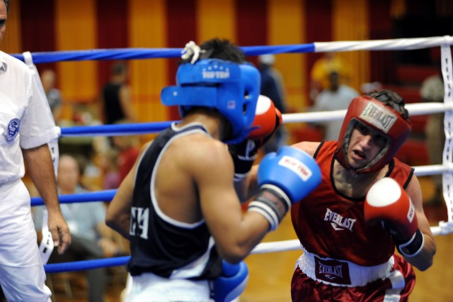 U.S. Army World Class Athlete Program boxer Capt. Michael Benedosso advanced to the light flyweight finale of the 2010 CISM Military World Boxing Championships with an 8-3 victory over Pvt. Debendro Singh of India on Oct. 13 at Marine Corps Base Camp Lejeune, N.C. (cleared for public release, not for commercial use, attribution requested)