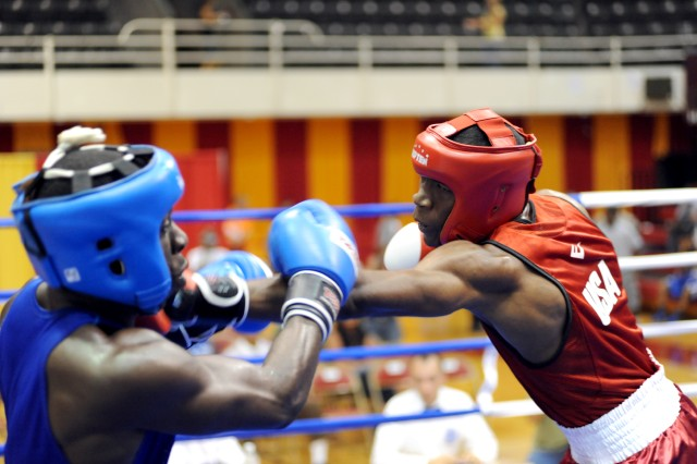 U.S. Marine Corps Cpl. Damarias Russell of Camp Lejeune, N.C., throws a left jab at PNR Donald Als of Barbabos during a middleweight quarterfinal of the 2010 CISM World Military Boxing Championships Oct. 12 at Marine Corps Base Camp Lejeune. Russell prevailed when the referee stopped the contest at 1:55 of the second round. (cleared for public release, not for commercial use, attribution requested)