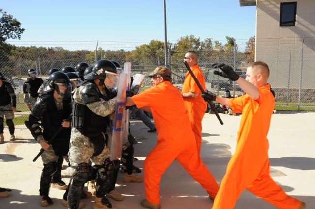 Military Police intern resettlement specialist Soldiers from Company C, 701st Military Police Battalion, quell a prison riot during a field training exercise, Oct. 15, at Fort Leonard Wood, Mo.