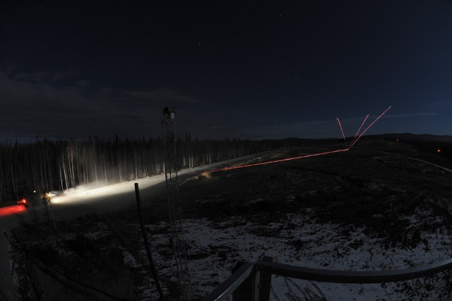 FORT WAINWRIGHT, Alaska - As a Stryker Mobile Gun System from the 1st Stryker Brigade Combat Team, 25th Infantry Division moves downrange during proficiency training in the Yukon Training Area, it unleashes a barrage of tracer rounds from its 50-caliber machinegun at a target.