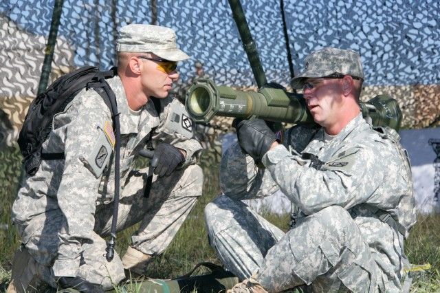 Sgt. Brandon Miller, at left, talks Staff Sgt. Mitch Rountree through the firing sequence of a 54 mm anti-tank round at Brig. Gen. Horace Sanders Forward Operating Base on Fort Sill Thursday. The noncommissioned officers assigned to the 100th Brigade Support Battalion were in the field two days practicing basic soldiering skills to prepare for a unit field training exercise later this year.