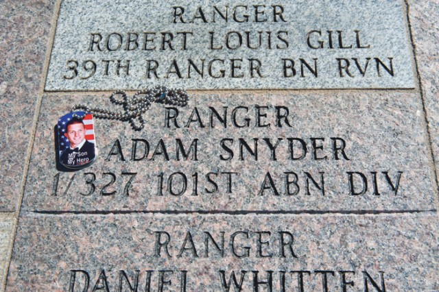CPT Adam Snyder was one of the 230 names added to the National Ranger Memorial over the summer. He was a member of the U.S. Military Academy at West Point's 2004 graduating class. CPT Snyder died Dec. 5, 2007, in Balad, Iraq, from wounds suffered when his vehicle encountered an improvised explosive device. Following the dedication ceremony, his mother used paper and a pencil to make a rubbing of his paver on the memorial's walkway.