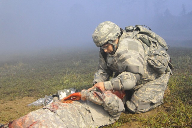 Staff Sgt. Alicia Anderson, U.S. Army Europe, tends to a Soldier felled by a roadside bomb.  The scenario was part of the Warrior Tasks and Battle Drills portion of the Best Warrior Competition held at Fort Lee Oct. 21 (photo by T. Anthony Bell).