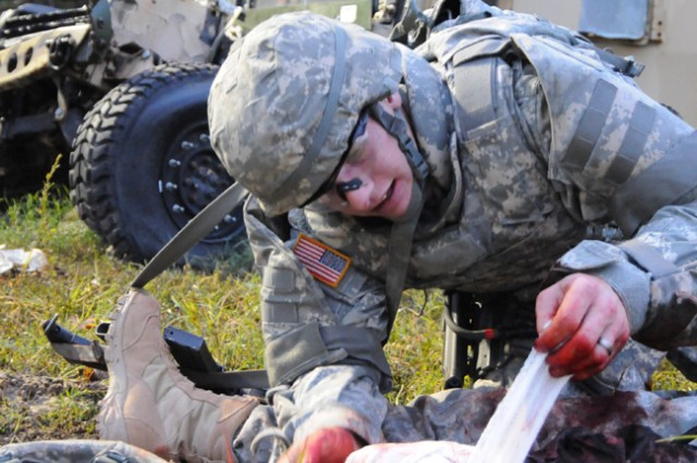Sgt. Eric Sincore, U.S. Army Europe, bandages a severed leg during the Warrior Tasks and Battle Drills phase of the Best Warrior Competition held at Fort Lee, Va. Oct. 21.