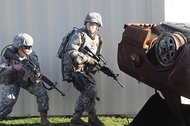 Staff Sgt. Alicia Anderson leads Soldiers alongside a building during one of the Warrior Tasks and Battle Drills of the Best Warrior Competition held at Fort Lee, Va. Oct. 22. (Photo by T. Anthony Bell)