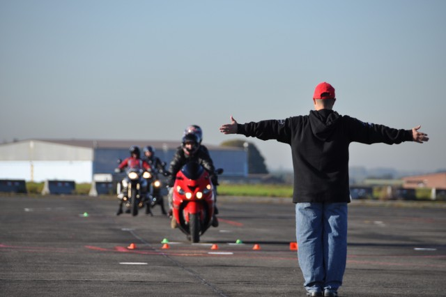An expert rider coach evaluates motorcyclists' handling skills Oct. 21 on ChiAfA..vres Air Base as part of Motorcycle Safety Awareness Day.