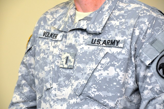 The Chief Warrant Officer Five insignia of rank, affixed to the Army Combat Uniform of newly-promoted Chief Warrant Officer Kenneth D. Volker, Headquarters, U.S. Army Reserve Command (Forward), Fort Bragg, N.C.