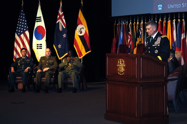 Lt. Gen. Robert L. Caslen Jr., Command and General Staff College commandant and commander of the Combined Arms Center and Fort Leavenworth, introduces the inductees to the International Hall of Fame Oct. 15 at the Lewis and Clark Center's Eisenhower Auditorium. Inducted were Gen. Eui Don Hwang, chief of staff of the Republic of Korea Army, who was represented at the ceremony by the Korean Liaison to CAC Lt. Col. Yoonkap Lim; Maj. Gen. Richard Rhys Jones, chief of the New Zealand Army; and Gen. Aronda Nyakairima, chief of Uganda Defence Forces.