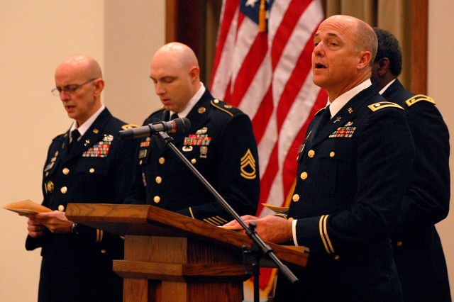 "Chaplain (Lt. Col.) Walter Hoskins leads dedication service attendees in ""O God, Our Help In Ages Past"" Oct. 18 at Frontier Chapel, Fort Leavenworth, Kan."