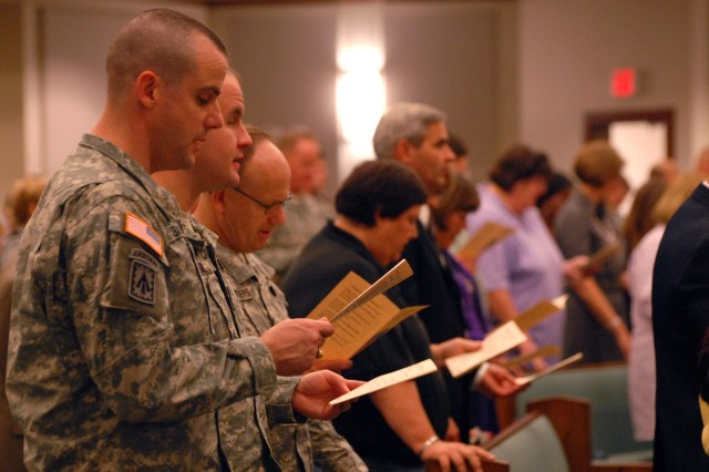 Chaplain (Maj.) Geoff Bailey and Chaplain (Maj.) Rob Allman, both of the 2011-01 Intermediate Level Education class at the Command and General Staff College, read in unison with others Oct. 18 at the dedication service for Frontier Chapel, Fort Leavenworth, Kan.